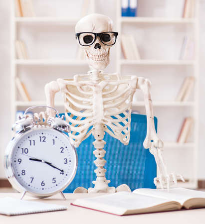 The skeleton businessman working in the office