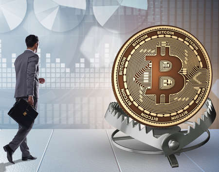 The businessman falling into the trap of bitcoin cryptocurrency Foto de archivo