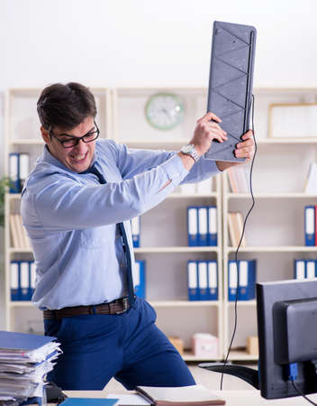 Angry businessman frustrated with too much work Stock Photo