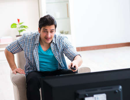 Man watching tv at home