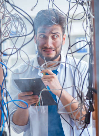 Electrician trying to untangle wires in repair concept Stock fotó