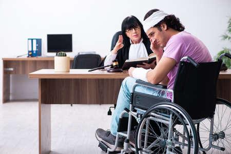 Disabled man consulting judge for damages litigation