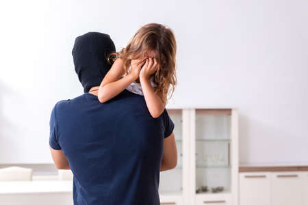 Child trafficking and abuse concept with small girl Zdjęcie Seryjne