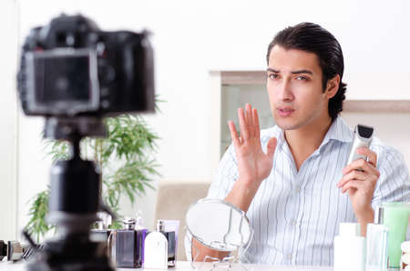 Young handsome man recording his blog in hygiene concept