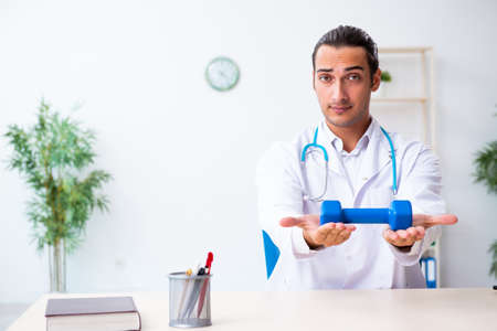 Young male doctor in sport and dieting concept