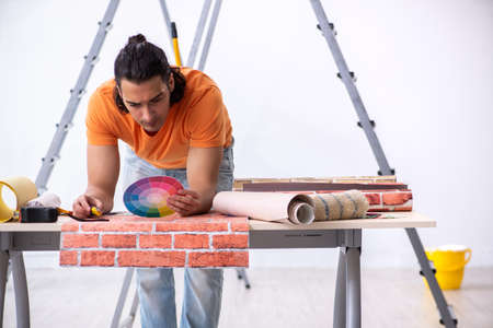 Young man contractor doing renovation at home