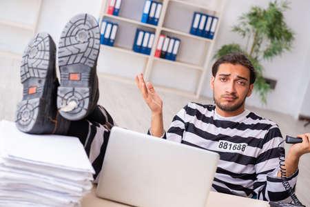 Young employee feeling like prisoner at work