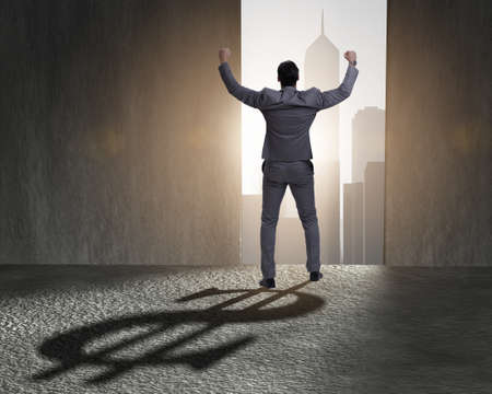 L'homme d'affaires jette une ombre en forme de dollar dans le concept d'entreprise Banque d'images