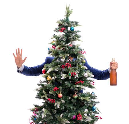 Businessman decorating christmas tree isolated on white