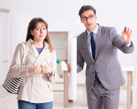 Real estate agent showing new apartment property to client
