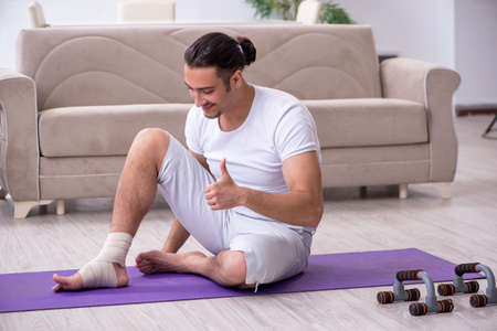 Leg injured man doing exercises at home