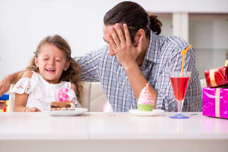 Father celebrating birthday with his daughter Stock Photo