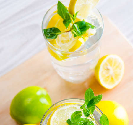Glasss of mojito with lemon and drinking straw Stock fotó
