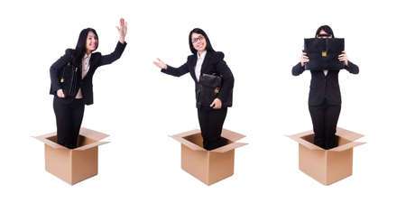 Businesswoman in thinking out of box concept Stock Photo