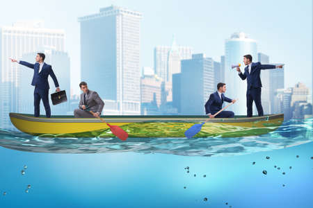 Disagreement concept with businessmen rowing in different direct Stock Photo