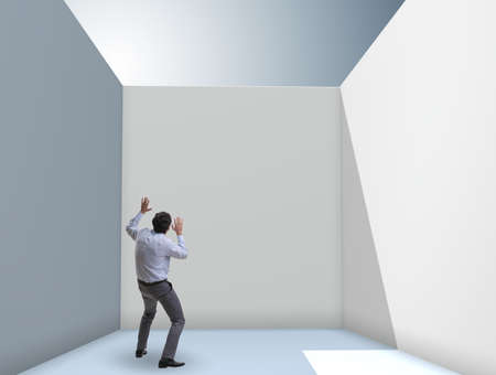 Businessman trying to escape from difficult situation Reklamní fotografie