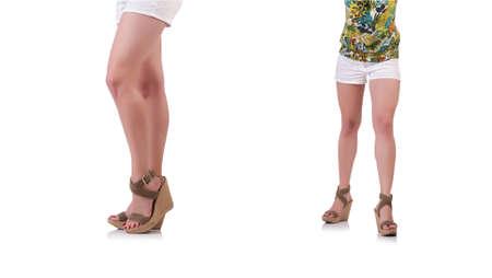 Female legs isolated on white