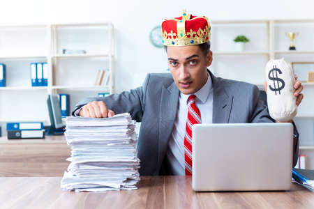 King businessman at his workplace