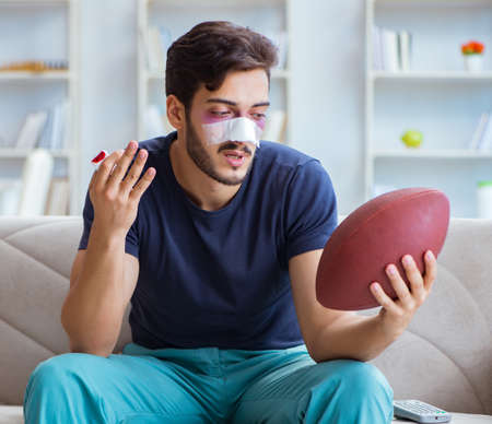 Young man defeated in sports game suffered loss with broken blee Stock Photo