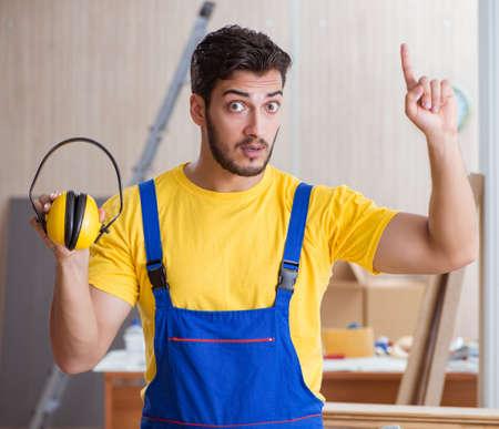 Young repairman carpenter working cutting wood