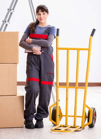 Woman contractor moving boxes in relocation concept