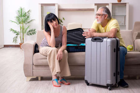 Old couple preparing for vacation travel Reklamní fotografie - 134964348