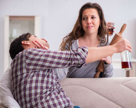 Domestic violence concept in a family argument with drunk alcoho Reklamní fotografie