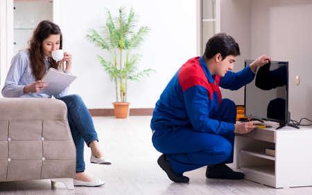 Tv repairman technician repairing tv at home