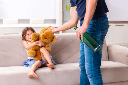 Drunk father in domestic child abuse and violence concept Stock Photo