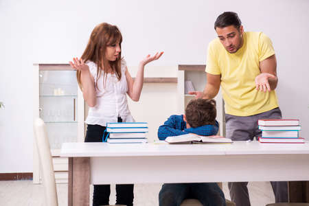Parents helping their son to prepare for school