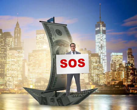 Businessman asking for help with SOS message on boat Archivio Fotografico