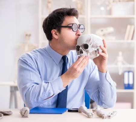 Funny crazy professor studying human skeleton Reklamní fotografie