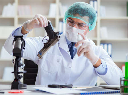 The forensics investigator working in lab on crime evidence Archivio Fotografico