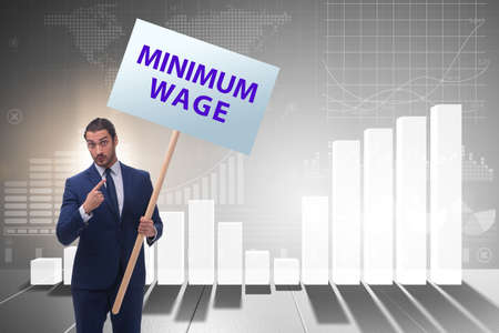 Concept of minimum wage with businessman Banco de Imagens