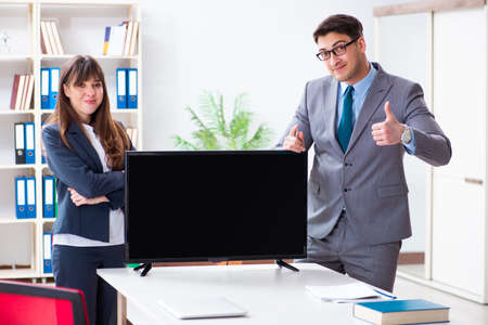 Young employee making presentation to his female boss
