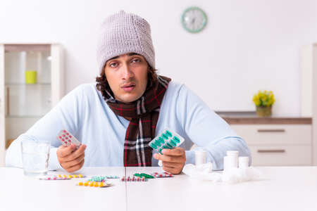 Young man suffering from flu at home