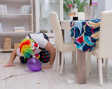 The drunk clown celebrating having a party at home