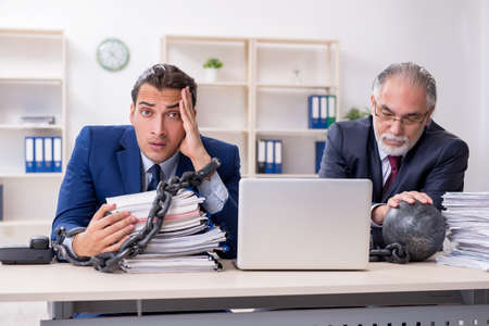 Two male employees unhappy with excessive work