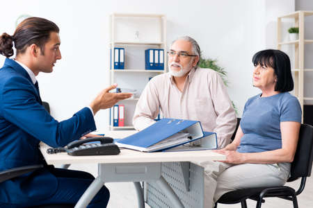 Financial advisor giving retirement advice to old couple Stock Photo
