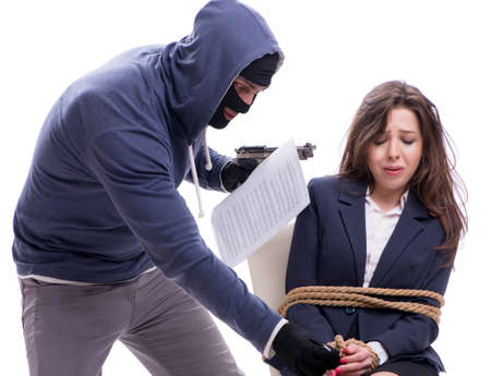 The gunman forcing a woman Stock Photo