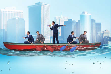 Disagreement concept with businessmen rowing in different directions