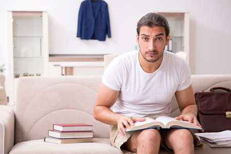 Young male student preparing for exams at home Stock fotó