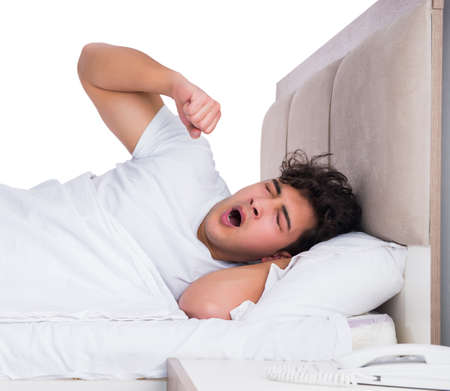 Man in bed suffering from insomnia Banco de Imagens