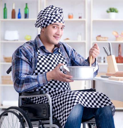 Disabled man preparing soup at kitchen Zdjęcie Seryjne - 138605040