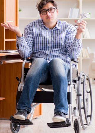 The disabled student studying at home on wheelchair Zdjęcie Seryjne - 138604962