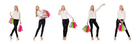 The woman many shopping bags after shopping isolated on white