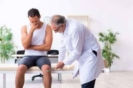 The young male patient visiting experienced doctor