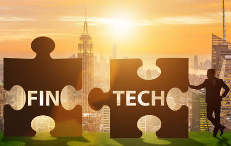 The fintech financial technology concept with puzzle pieces 스톡 콘텐츠