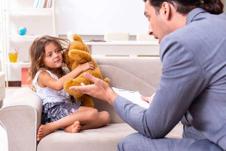Child psychologist attending small girl