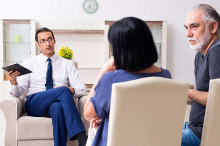 Old couple visiting psychiatrist doctor